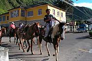 Riding horses in the streets in Banos, Ecuador.