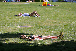 © Licensed to London News Pictures. 19/05/2020. London, UK. Sunbathers in Finsbury Park, north London on a warm and sunny day in the capital. The government has relaxed the rules on the COVID-19 lockdown, allowing people to spend more time outdoors whilst following social distancing guidelines. According to the Met Office, 27 degrees celsius is forecast for tomorrow. Photo credit: Dinendra Haria/LNP