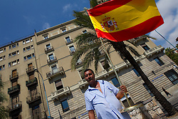 Fan with a Spanish flag at the Mens Marathon during day six of the 20th European Athletics Championships at the roads of city Barcelona on August 1, 2010 in Barcelona, Spain. (Photo by Vid Ponikvar / Sportida)