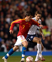Photo: Paul Greenwood.<br />England v Spain. International Friendly. 07/02/2007. Spains David Villa, left, shields the ball from Englands Johnathan Woodgate