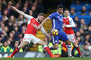 Shkodran Mustafi of Arsenal intercepts Diego Costa of Chelsea. Premier league match, Chelsea v Arsenal at Stamford Bridge in London on Saturday 4th February 2017.<br /> pic by John Patrick Fletcher, Andrew Orchard sports photography.