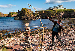Dunbar, East Lothian, Scotland, United Kingdom. European Stone Stacking Championship announcement. James Craig Page, organiser of the annual event, cancelled in 2020 due to Covid-19 pandemic, will announce dates for it to take place in July at this weekend's online World  Rock  Balancing  Championships at Llano  Earth  Art  Festival,  normally in Texas, but streaming live to encourage participants across the world to create a stone balanced sculpture wherever they are. James has created stone sculptures daily throughout the pandemic.<br /> Sally Anderson   EdinburghElitemedia.co.uk