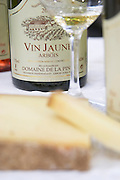 bottle and glass of arbois vin jaune wine and comte cheese domaine de la pinte arbois france