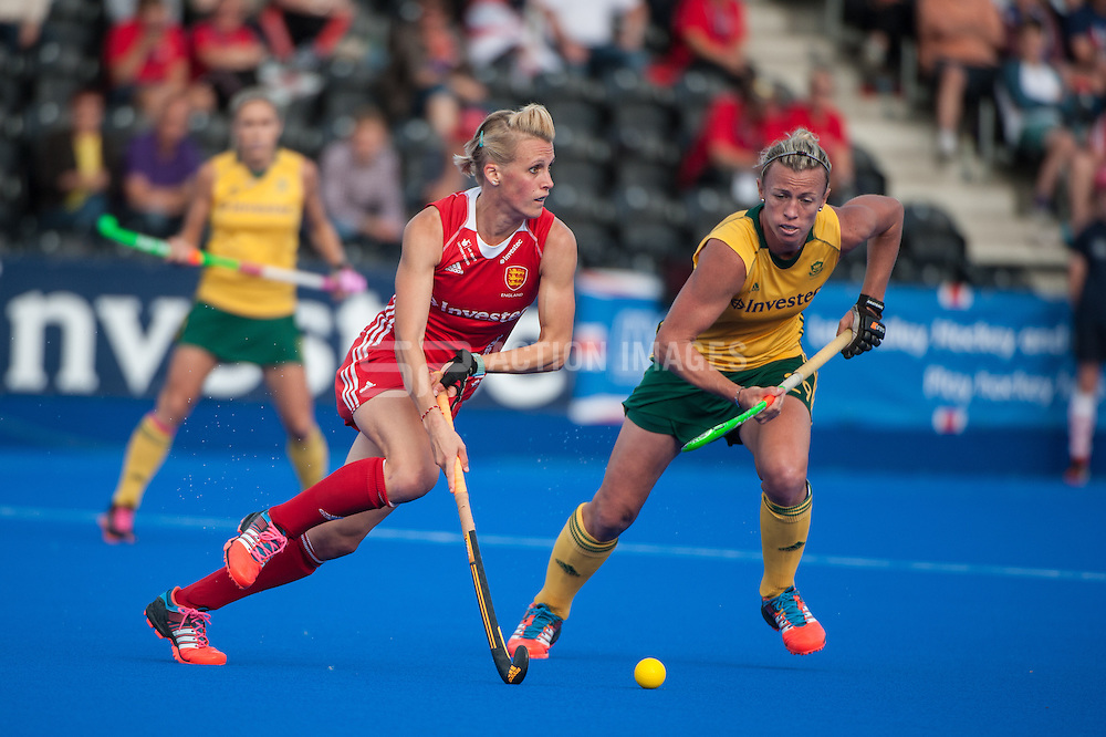 England's Alex Danson is challenged by Tarryn Bright of South Africa during the Final of the Investec London Cup. Lee Valley Hockey & Tennis Centre, London, UK on 13 July 2014. Photo: Simon Parker