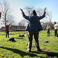 Nederland, Amsterdam , 11 maart 2012..Falun Dafa, een chinese spirituele beweging (soort van yoga). Zondag vindt er een training plaats in het Westerpark. De Falun Dafa wordt in China vervolgd. Mevrouw Wang geeft deze training en ook zij en haar familie worden in China vervolgd. Gaat om haar persoonlijke verhaal..Op de foto is Mevr. Wang niet aanwezig. .People practicing Falun Dafa in Westerpark in Amsterdam. The Falun Gong is banned in China and practitioners are persecuted
