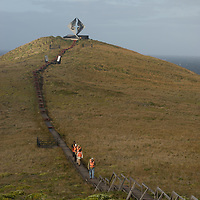 Tourists visit Cape Horn Memorial, designed in the shape of an albatross by Chilean sculptor José Balcells to commemorate sailors rounding tip of South America.