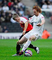 Photo: Leigh Quinnell/Sportsbeat Images.<br /> Milton Keynes Dons v Chesterfield. Coca Cola League 2. 24/11/2007. MK Dons Dean Lewington battles with Chesterfields  Jamie Ward.