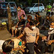 1 May 2021<br /><br />Indirapuram, Gazhiabad<br />Relatives and patients struggling to breathe seen at the Indirapuram Gurudwara ( Sikh Temple) where a free oxygen camp has been organised for Covid positive patients who have not found a hospital or oxygen support . A massive spike in cases caught the administration and hopsitals unprepared , this  in the national capital region. Lack of hospital beds , oxygen and ICU facilities has meant good samaritans are stepping up and trying to fill the gaps.
