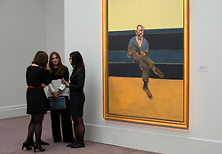 © Licensed to London News Pictures. 12/04/2013. London, UK. People stand next to Francis Bacon's 'Study for a Portrait of P. L.' painting with an estimated value of between 30 - 40 million USD for the upcoming New York auctions. Highlights from Sotheby's New York auctions of Impressionist and Modern Art and Contemporary Art will be exhibited to the public from 12-16 April at  Sotheby's London New Bond Street galleries. Photo credit : Peter Kollanyi/LNP