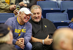 Dec 1, 2019; Morgantown, WV, USA; West Virginia Mountaineers head coach Bob Huggins talks to a fan prior to their game against the Rhode Island Rams at WVU Coliseum. Mandatory Credit: Ben Queen-USA TODAY Sports