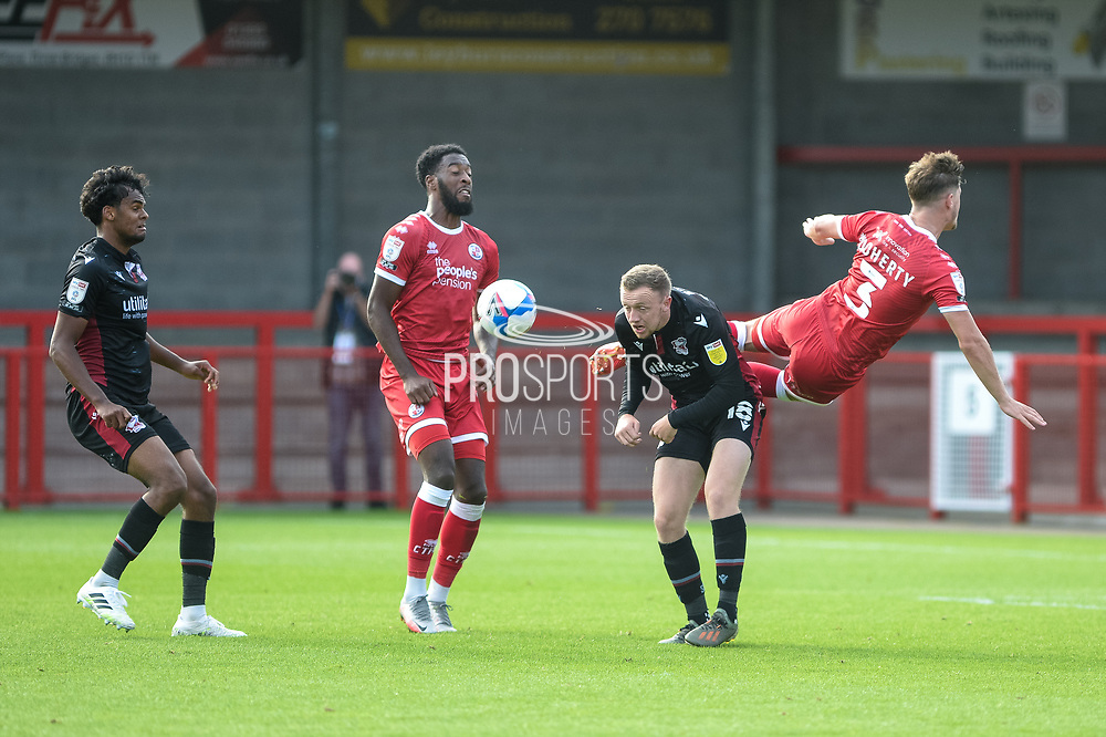 Josh Doherty of Crawley Town Jordan Hallam (18) of Scunthorpe United battles for possession with during the EFL Sky Bet League 2 match between Crawley Town and Scunthorpe United at The People's Pension Stadium, Crawley, England on 19 September 2020.