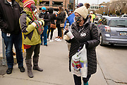 29 OCTOBER 2020 - DES MOINES, IOWA: MARY HORSMAN, right, hands out hot chocolate to voters waiting in line at the Polk County Auditor's Office in Des Moines. There have been long lines for early voting all month. According to the Polk County Auditor's Office, as of October 27, 120,752 ballots have been returned of the 144,028 ballots requested for a return rate of 83.84 percent. Iowa starts counting early ballots the morning of Nov. 3.     PHOTO BY JACK KURTZ