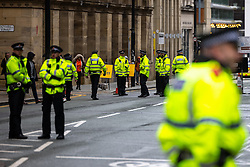 © Licensed to London News Pictures . 02/10/2021. Manchester, UK. Police patrol and security barriers are erected around a secure zone , consisting of the Midland Hotel and Manchester Central Convention Centre , on the eve of the Conservative Party Conference . The Conservative Party Conference takes place at the Manchester Central Exhibition Centre from tomorrow (3rd October 2021). Photo credit: Joel Goodman/LNP