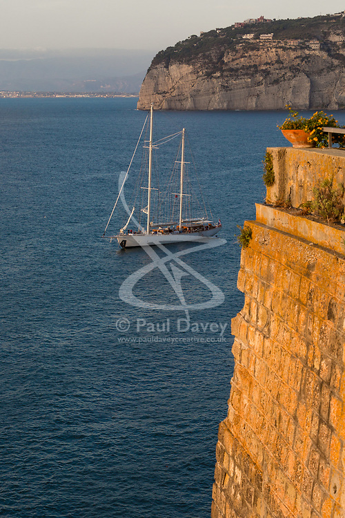 Sorrento, Italy, September 20 2017. The masts of a large yacht catch the late afternoon sun in Sorrento, Italy. © Paul Davey