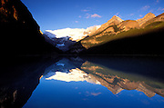 Dawn light on Mount Victoria reflected in Lake Louise, Banff National Park, Alberta, Canada.