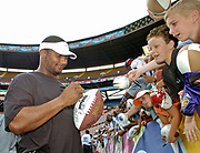 Feb 7, 2004, Honolulu, Hawaii, USA;  Steve McNair of the Tennessee Titans signs autographs for fans after the AFC practice for the NFL Pro Bowl at Aloha Stadium.