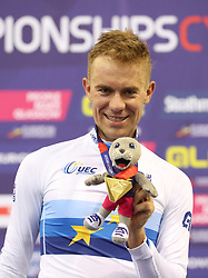 Poland's Wojciech Pszczolarski on the podium after winning the Gold Medal in the Mens 40km Points Race during day four of the 2018 European Championships at the Sir Chris Hoy Velodrome, Glasgow. PRESS ASSOCIATION Photo. Picture date: Sunday August 5, 2018. See PA story CYCLING European. Photo credit should read: Jane Barlow/PA Wire. RESTRICTIONS: Editorial use only, no commercial use without prior permission