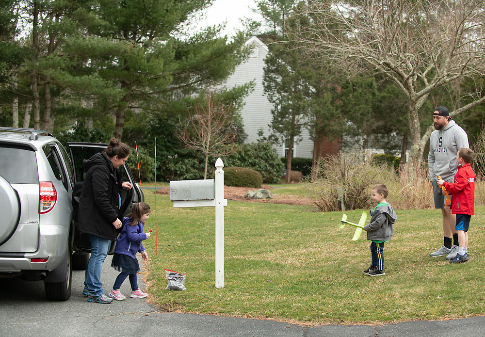 CENTERVILLE - 4-year-old Maddie Hanchuruck is a stickler for social distancing rules. With her mother, Liz Hanchuruck, she dropped off a seed planting kit for friends Sawyer Stone, 3, and William Stone, 7, and their father, J.D. Stone, but made sure to stay back the appropriate distance.