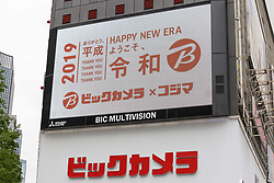 May 1, 2019 - Tokyo, Japan - A big screen displaying a greeting message of Japan's new imperial era ''Reiwa'' is seen outside Bic Camera electronics store in downtown Tokyo. Japan's new emperor Naruhito formally ascended the Chrysanthemum Throne, today May 1st, a day after his father Akihito abdicated. Naruhito became the 126th emperor of Japan starting the new imperial era of Reiwa, meaning beautiful harmony. (Credit Image: © Rodrigo Reyes Marin/ZUMA Wire)