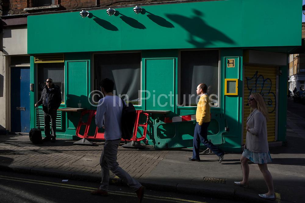 Street Scene of interacting colours in Soho, London, England, United Kingdom.