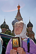 Moscow, Russia, 02/08/2006..A woman prays in front of Saint Basil's Cathedral as Russian Orthodox believers celebrate Saint Ilyin's Day in and around Red Square.
