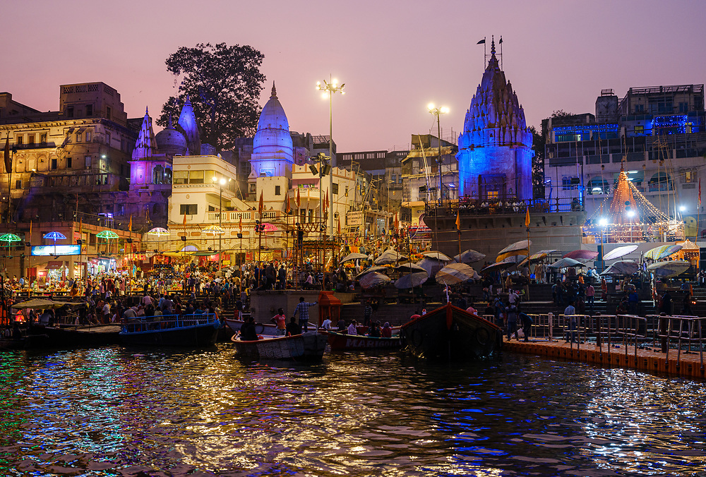 Varanasi, INDIA - CIRCA NOVEMBER 2018: Dashashwamedh Ghat In Varanasi. This  is the main ghat in Varanasi on the Ganga River. It is located close to Vishwanath Temple and is probably the most spectacular ghat and a popular tourist attraction. Varanasi is the spiritual capital of India, the holiest of the seven sacred cities and with that one the most frequented places for Sadhus.