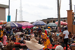 April 12, 2020, Lagos, Nigeria: Residents buy and sell at Oke-Odo Food Market, Ile-Epo, Lagos, Nigeria on Sunday, April 12, 2020. Christians celebrate Easter festival indoor in compliance with of ongoing stay-at-home and lockdown orders by the government to contain the spread of Coronavirus (COVID-19) pandemic. (Credit Image: © Adekunle Ajayi/NurPhoto via ZUMA Press)