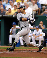 July 24, 2007 - Kansas City, MO..New York Yankees shortstop Derek Jeter drives the ball to right field in the second inning against the Kansas City Royals at Kauffman Stadium in Kansas City, Missouri on July 24, 2007...MLB:  The Yankees defeated the Royals 9-4.  .Photo by Peter G. Aiken/Cal Sport Media