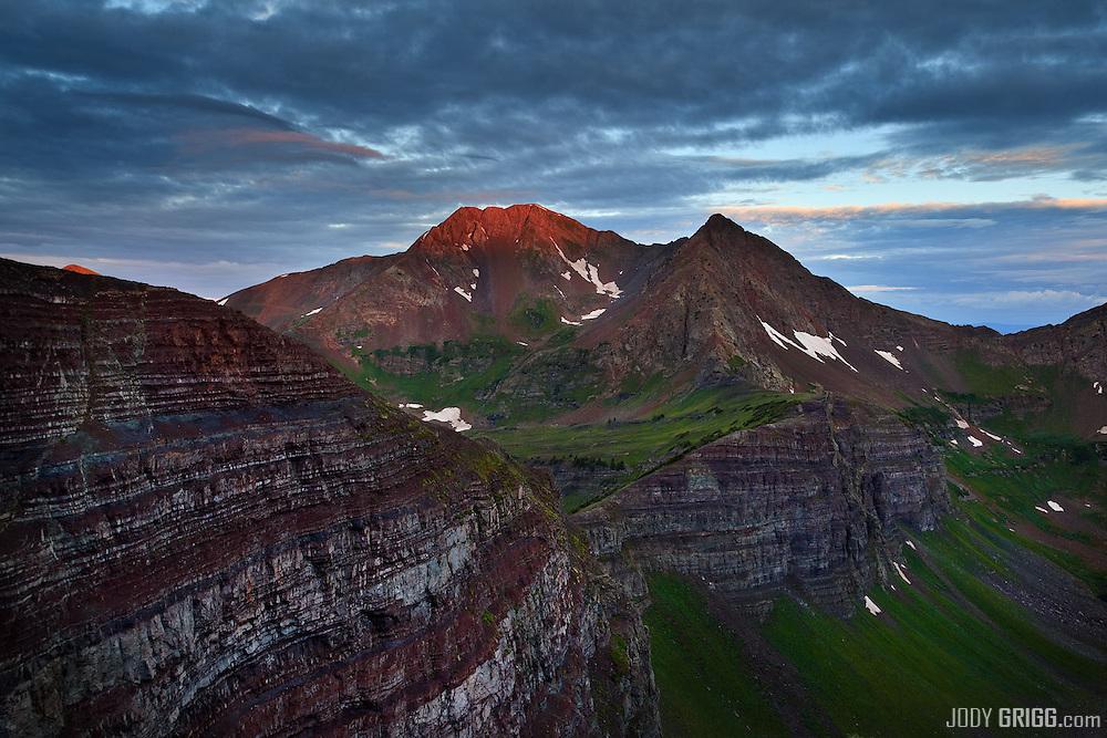 Sunrise along Scarp Ridge onto Owen and Ruby peaks near Crested Butte, Colorado.