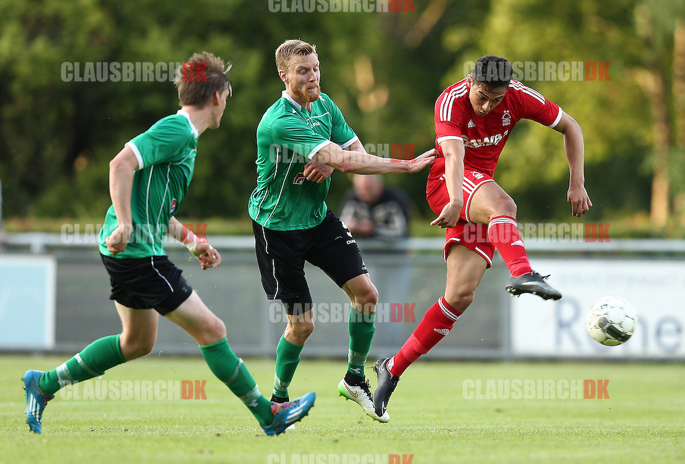 FOOTBALL: Tyler Walker (Nottingham Forest) is challenged by Andreas Holm (FC Helsingør) but scores his team's first goal during the pre-season match between FC Helsingør and Nottingham Forest at Helsingør Stadion on July 14, 2015 in Helsingør, Denmark. Photo: Claus Birch / ClausBirch.dk