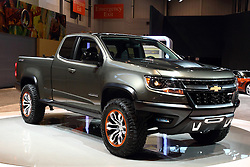 """12 February 2015: 2015 CHEVROLET COLORADO:  Starring inside the Chevrolet exhibit during the 107th Chicago Auto Show is the 2015 Chevrolet Colorado that redefines the midsize truck. Developed for the North American truck customer, the aggressive design is unique, with taller bedsides and raked belt line of the cab described as """"the younger, more eager brother of the Silverado.""""  For the 2015 model year, the redefined Colorado is available in WT, LT and Z71 trim levels, and in rear-wheel and all-wheel drive configurations. Body/bed layouts come in an extended cab model with a six-ft. two-in. bed, a crew cab with a five-ft. two-in. bed and a crew cab with a six-ft. two-in. bed. With the tailgate down, the six-foot bed allows hauling of eight-foot-long items. Two engines on the checklist include the 193-horsepower 2.5-liter four-cylinder engine, and a 302-hp 3.6L V-6, with each connected with a six-speed automatic transmission. There is a six-speed manual gearbox offered on extended cab two-wheel Work Truck models. In 2016, Colorado will begin offering the segment's only diesel engine – a proven Duramax 2.8L I-4 turbodiesel. The diesel engine will expand Colorado's powertrain lineup to cover the broadest range of needs. When properly equipped, the Colorado offers class leading payload capacity and trailering capacity of more than 6,700 pounds. For those looking for the brawniest Colorado, check-out the off-road-inspired Z71with its gunmetal grille surround, projector headlamps and unique 17-inch aluminum wheels.<br /> <br /> First staged in 1901, the Chicago Auto Show is the largest auto show in North America and has been held more times than any other auto exposition on the continent. The 2015 show marks the 107th edition of the Chicago Auto Show. It has been  presented by the Chicago Automobile Trade Association (CATA) since 1935.  It is held at McCormick Place, Chicago Illinois"""