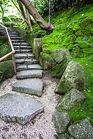 "Moss Steps at Hokoku-ji  - Hokoku-ji Kamakura is world famous for its bamboo garden containing more than 2000 Moso bamboos trees. Its nickname is Take-dera ""Bamboo Temple"" for that reason.  The bamboo garden is punctuated with stone lanterns, jizo and moss covered stones.  Besides the popular bamboo garden, and teahouse, Hokokuji also has a often overlooked Zen garden   Ashikaga Ietoki, ordered Zen priest Tengan Eko to establish Hokoku-ji. This temple became the family temple of the Ashikaga clan. Tengan was a disciple of Mugaku Sogen a contemporary of famous garden designer Muso Kokushi."