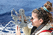 North Atlantic Ocean, October 2014.<br /> First mate Shanley McEntee takes a sextant reading,  on board the Sea Dragon.<br />  © Chiara Marina Grioni