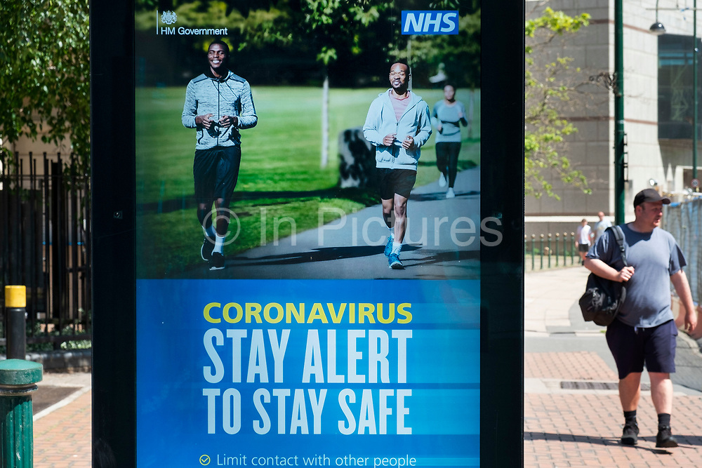 HM Government and NHS advertising boards advice to stay alert to the symptoms as the Coronavirus lockdown continues, the city centre is still very quiet while more traffic and people are returning, and with restrictions due to be relaxed further in the coming days, the quiet city may be coming to an end as businesses are set to start to reopen soon on 27th May 2020 in Birmingham, England, United Kingdom. Coronavirus or Covid-19 is a respiratory illness that has not previously been seen in humans. While much or Europe has been placed into lockdown, the UK government has put in place more stringent rules as part of their long term strategy, and in particular social distancing.