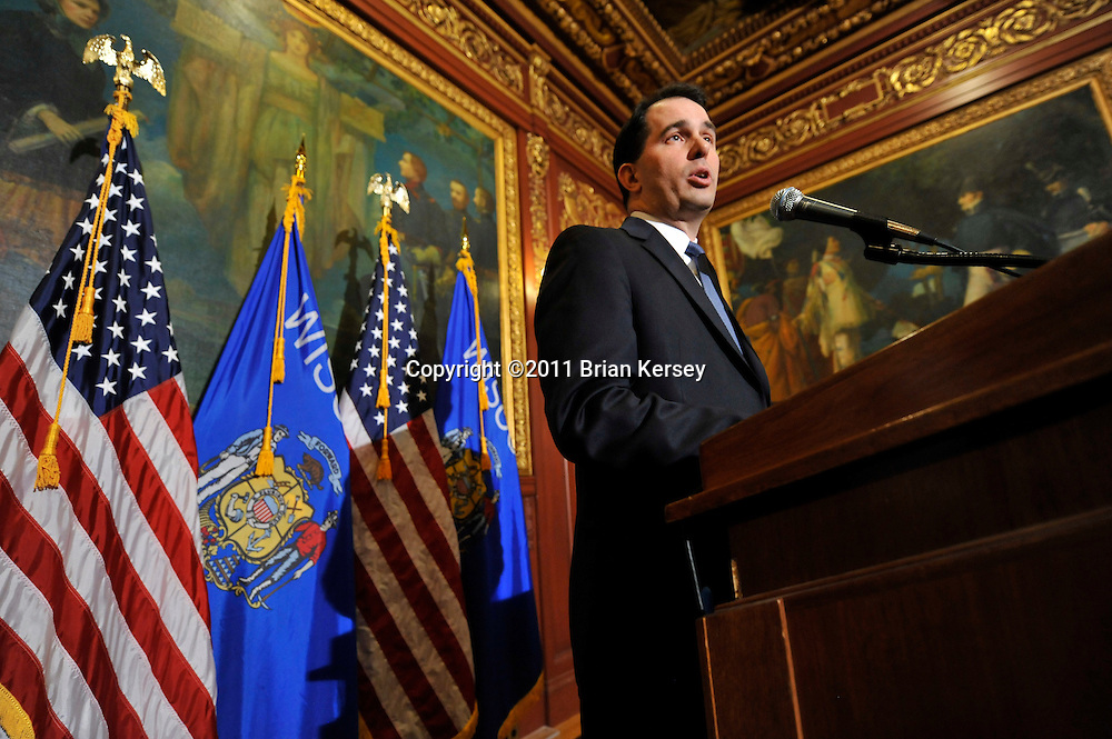 Wisconsin Gov. Scott Walker talks to reporters during a news conference at the state Capitol in Madison, Wisconsin on February 24, 2011. The legislature is considering legislation proposed by Walker that includes cuts in benefits for state workers and takes away many of their collective bargaining rights.    (Photo by Brian Kersey)