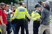 Police officers seperate pro leave protesters from pro remain campaigners in Westminster on the day that Parliament reconvenes after summer recess to debate and vote on a bill to prevent the UK leaving the EU without a deal at the end of October, on 3rd September 2019 in London, England, United Kingdom.