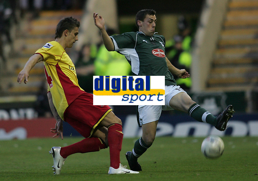 Photo: Lee Earle.<br /> Plymouth Argyle v Watford. The FA Cup. 11/03/2007.Plymouth's Gary Sawyer (R) clears from Tamas Priskin.