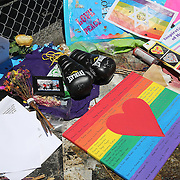 Olympian and professional boxer Orlando Cruz of Puerto Rico pays his respects to the victims of the Pulse Nightclub shooting by leaving a pair of boxing gloves on Tuesday, July 12, 2016 in Orlando, Florida. Cruz, who lost four friends in the tragic incident was the first openly gay boxer in the sport and will fight for his fifth time in the Orlando area this Friday.  (Alex Menendez via AP)