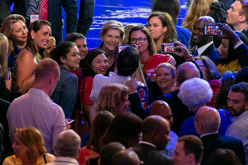 Democratic presidential candidate Sen. Elizabeth Warren (D-MA) takes a selfie with attendees at the end of the first primary debate for the 2020 elections at the Adrienne Arsht Center for the Performing Arts in downtown Miami on Wednesday, June 26, 2019.