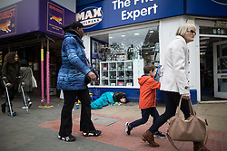© Licensed to London News Pictures . 06/04/2017 . Manchester , UK . A woman lies slumped in front of a branch of Max Spielmann Photographic , in Piccadilly Gardens . An epidemic of abuse of the drug spice by some of Manchester's homeless population , in plain sight , is causing users to experience psychosis and a zombie-like state and is daily being witnessed in the Piccadilly Gardens area of Manchester , drawing large resource from paramedic services in the city centre . Photo credit : Joel Goodman/LNP