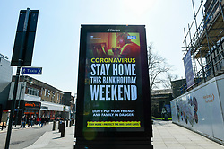 © Licensed to London News Pictures. 11/04/2020. WATFORD, UK. A digital advertising screen promotes a message in Watford shopping centre on Easter Saturday during lockdown as the coronavirus (COVID19) pandemic continues.  The NHS are requesting that people stay at home during the Bank Holiday weekend, even during the forecast hot weather.  Photo credit: Stephen Chung/LNP