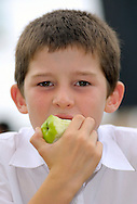 Young Boy Eating Apple - Model Released