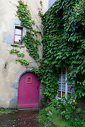 Pink door on house in the historic centre of Roscoff, Brittany, France