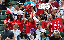 A general view of Roger Federer fans showing their support on day three of the Wimbledon Championships at the All England Lawn Tennis and Croquet Club, Wimbledon.