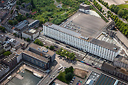 Nederland, Limburg, Gemeente Maastricht, 27-05-2013; Het Eiffelgebouw van de voormalige Koninklijke Sphinx gebouwd in dejaren 30 in de wijk Belvedere. In oktober 2013 is begonnen met de restauratie van het voormalige fabrieksgebouw aan de Boschstraat. Het gebouw vormt al jaren een landmark voor Maastricht.<br /> Eiffel Building of the former Royal Sphinx factory built in the 30s in the Belvedere area of Maastricht. The low-rise building is a well known landmark in Maastricht.<br /> luchtfoto (toeslag op standaardtarieven);<br /> aerial photo (additional fee required);<br /> copyright foto/photo Siebe Swart.