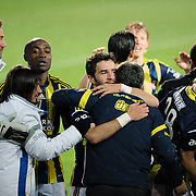 Fenerbahce's Gokhan Gonul (C) celebrate his goal with team mate during their Turkish SuperLeague Derby match Trabzonspor between Fenerbahce at the Avni Aker Stadium at Trabzon Turkey on Sunday, 17 February 2013. Photo by TURKPIX
