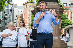 London, UK. 30 May, 2019. Kevin Courtney, Joint General Secretary of the National Education Union (NEU), addresses campaigners from SEND National Crisis attending a demonstration in Parliament Square to demand improvements in the diagnosis and assessment of young people with SEND, assistance for their families, funding and legal and financial accountability for local authorities in their treatment of young people with SEND and their families.