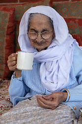 Sikh elderly grandmother drinking tea,