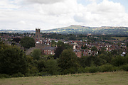 View towards the town of Ludlow and the parish church of St Laurences. Ludlow is a market town in Shropshire, England. With a population of approximately 11,000, Ludlow is the largest town in south Shropshire. The town is near the confluence of two rivers. The oldest part is the medieval walled town, founded in the late 11th century after the Norman conquest of England. It is centred on a small hill which lies on the eastern bank of a bend of the River Teme. Atop this hill is Ludlow Castle and the parish church, St Laurences, the largest in the county. From there the streets slope downward to the River Teme.