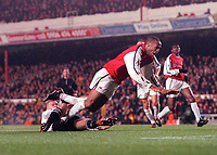 Thierry Henry (Arsenal) is tackled by Seth Johnson (Derby) as he bears down on goal. Arsenal 0:0 Derby County. F.A. Premiership, 11/11/2000. Credit: Colorsport / Stuart MacFarlane.